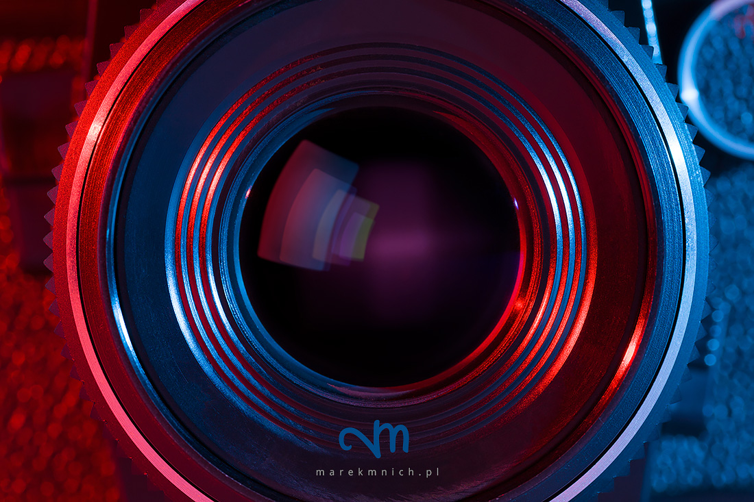 Close up of retro camera lens with red and blue lighting