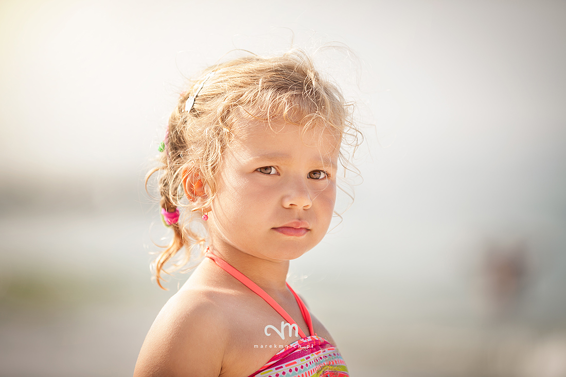 Serious cute little girl on beach