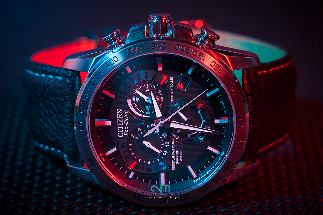 Citizen wristwatch illuminated with red an blue light