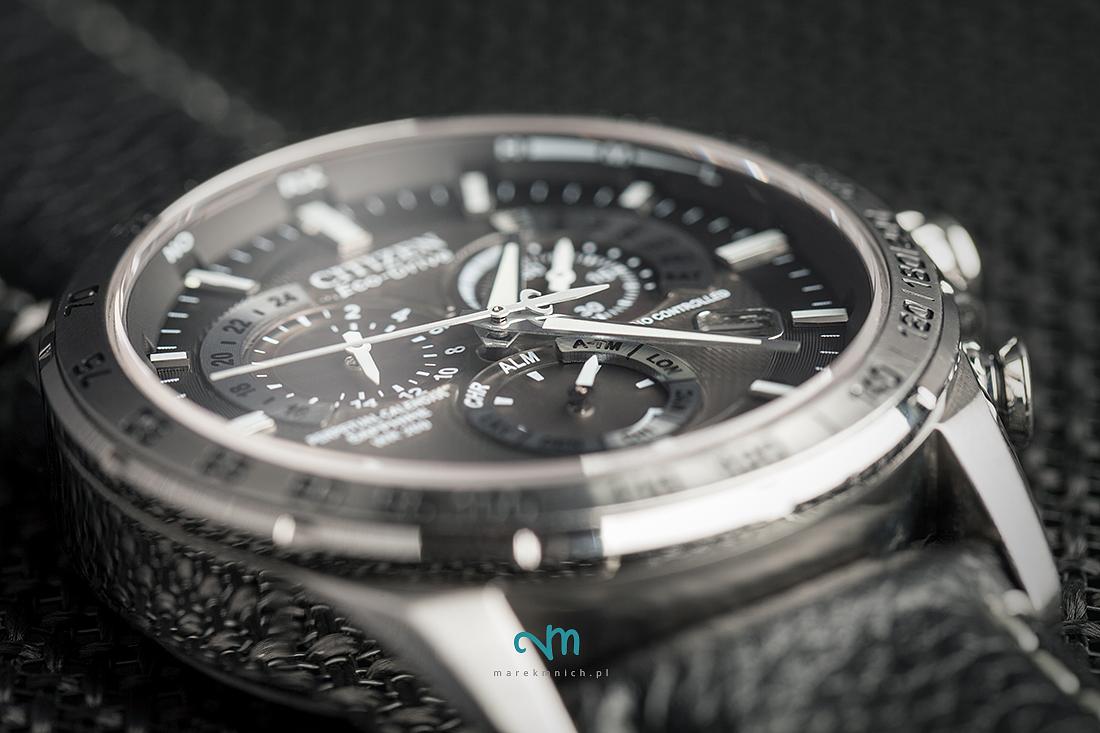 Citizen wristwatch closeup on black background