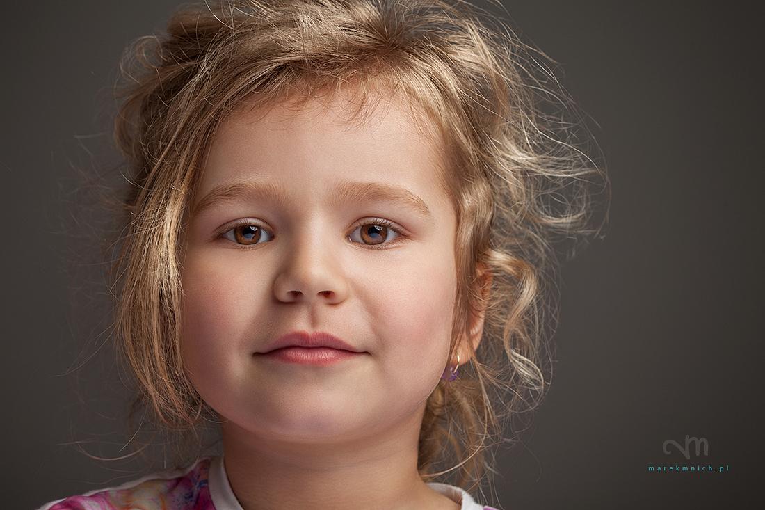 Disheveled cute little girl on grey background