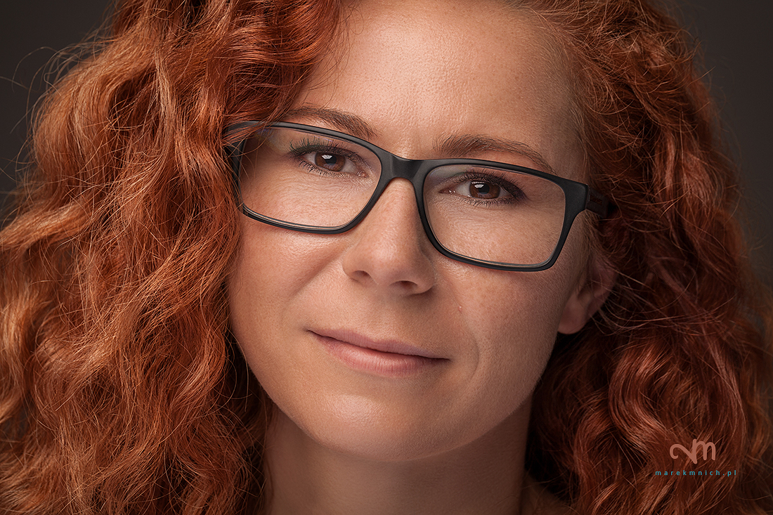 Close up portrait of red hair woman with eyeglasses