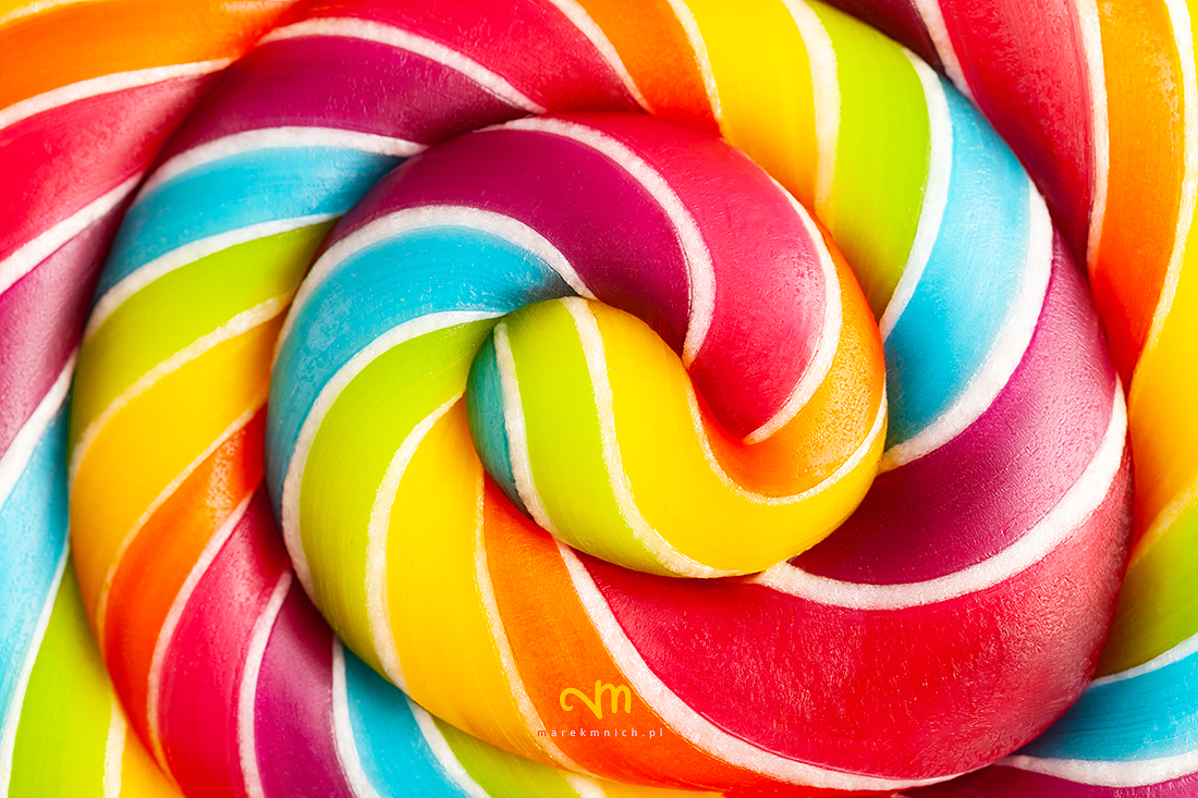 Close up of rainbow colored lollipop