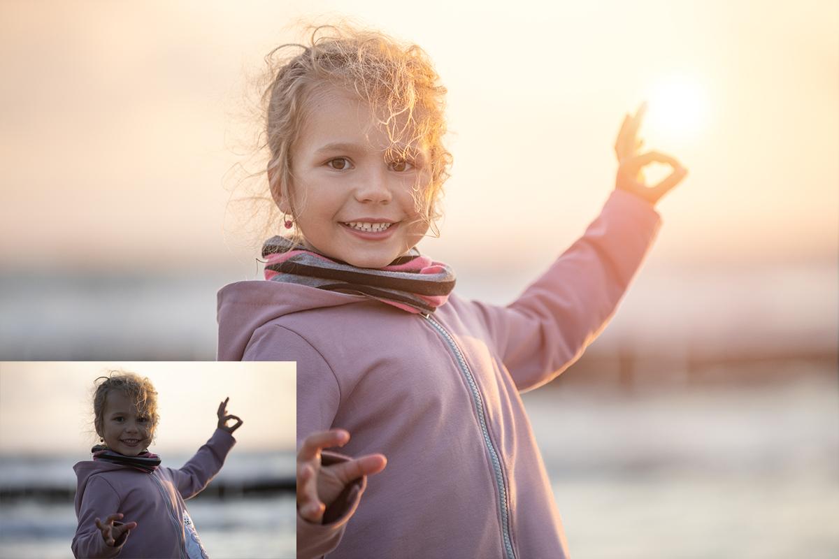 Smiling little girl on sunset baltic beach.